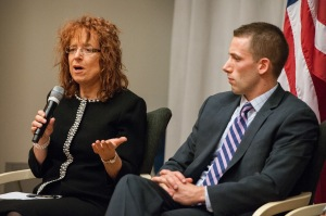 GLIFAA President Robyn McCutcheon speaks while GE's T.J. Mahoney looks on